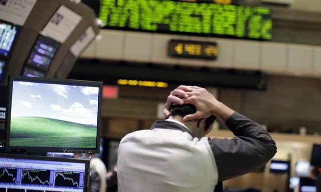 Trader works on the floor of the New York Stock Exchange