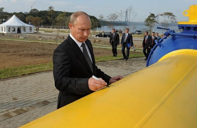 Russia's Prime Minister Vladimir Putin leaves his signature on a gas pipeline  during its opening ceremony in Russia's far eastern city of Vladivostok