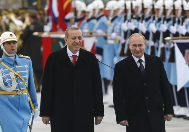 Russia's President Putin and Turkey's President Erdogan review a guard of honour during a welcoming ceremony in Ankara