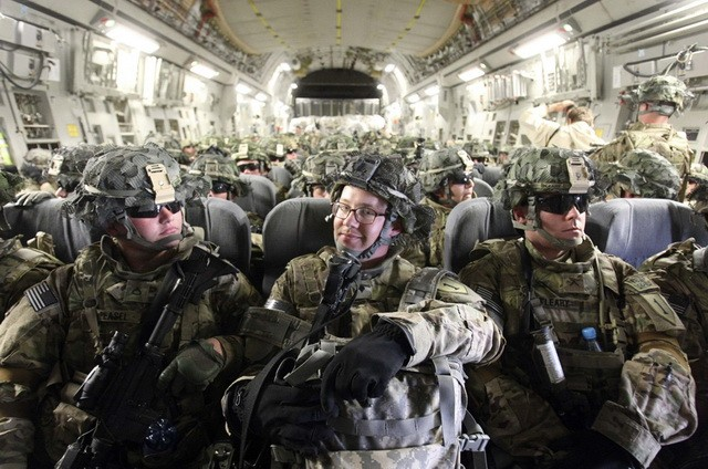 U.S. Army soldiers from Bravo Company, 234th Battalion, 1st Infantry Division, wait for takeoff inside their transport plane at Manas airport near Bishkek