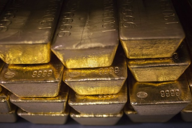 File of gold bars are seen at the United States West Point Mint facility in West Point, New York
