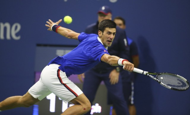 Novak Djokovic of Serbia returns the ball during the men's singles final match against Roger Federer at Arthur Ashe Stadium in New York.