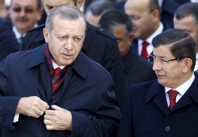 Turkey's President Erdogan chats with Prime Minister Davutoglu during a Republic Day ceremony at Anitkabir, the mausoleum of modern Turkey's founder Ataturk, in Ankara, Turkey