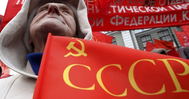 A Russian communist supporter takes part in a rally to mark the anniversary of the 1917 Bolshevik revolution in St. Petersburg