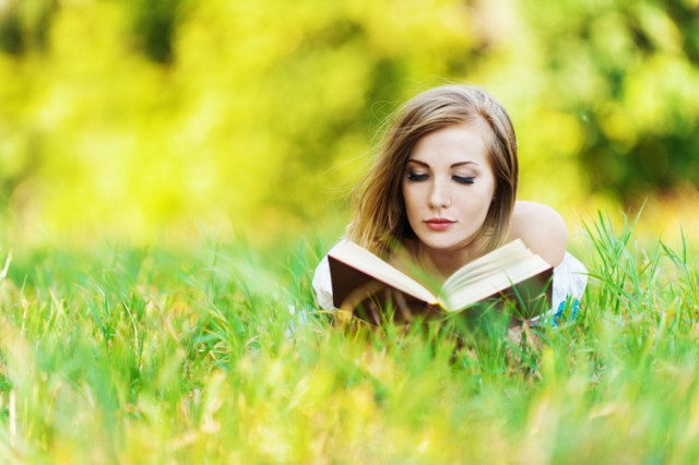 woman grass reading book